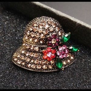 Gild tone and Crystal Hat brooch designer style
